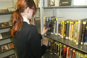 Pupil selecting a book in the Library